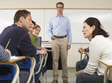 accuser: Students Talking in Classroom LANG_EVOIMAGES