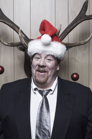 wood panelled: Businessman Wearing Santa Hat