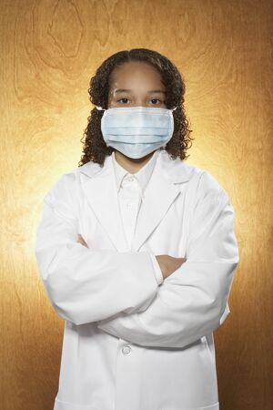 wood panelled: Young Girl Dressed as Doctor LANG_EVOIMAGES