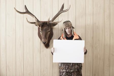 Hunter Holding up Blank Card LANG_EVOIMAGES