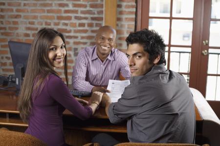 borrowing: Couple with Financial Advisor