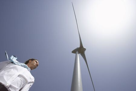 environmental issues: Businessman by Wind Tower