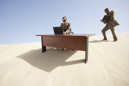 Business People Working in Desert