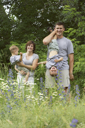 12 13: Portrait of Family Outdoors