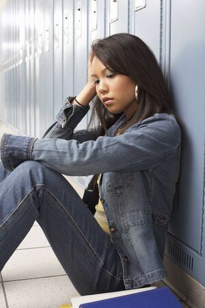 perturbed: Student Sitting in School Hallway