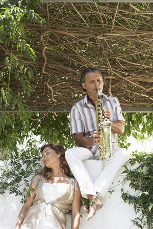 Man on Ledge Playing Saxophone