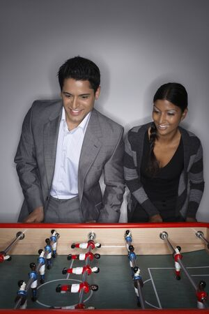 Man and Woman Playing Table Soccer