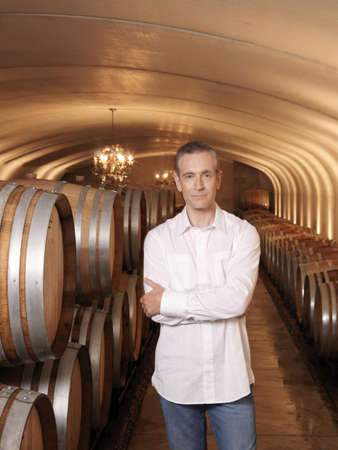 storage: Man Standing in Wine Cellar LANG_EVOIMAGES