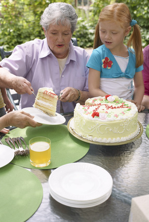 three generation: Grandmother and Granddaughter at Birthday Party