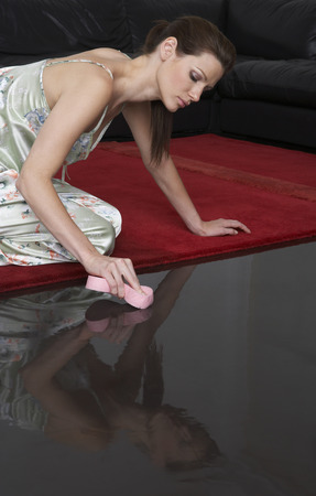 Woman Washing Floor LANG_EVOIMAGES