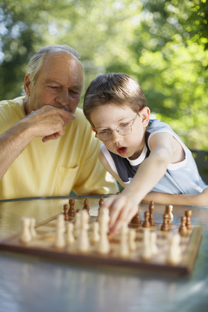 grampa: Grandfather and Grandson Playing Chess