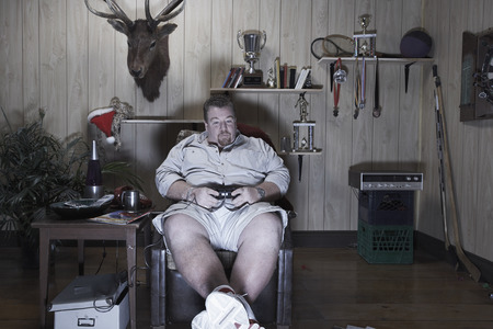 wood panelled: Man Playing Video Games LANG_EVOIMAGES
