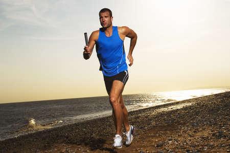 run down: Man Jogging on the Beach