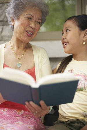 explained: Grandmother and Granddaughter Reading Book