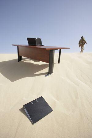 Businessman Leaving Workspace in Desert