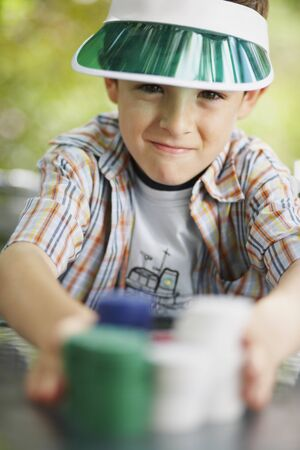 goodluck: Boy with Stacks of Poker Chips