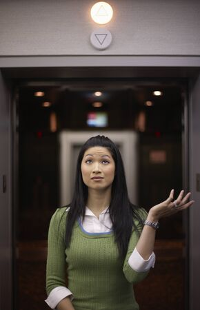 perturbed: Woman in Front of Elevator LANG_EVOIMAGES