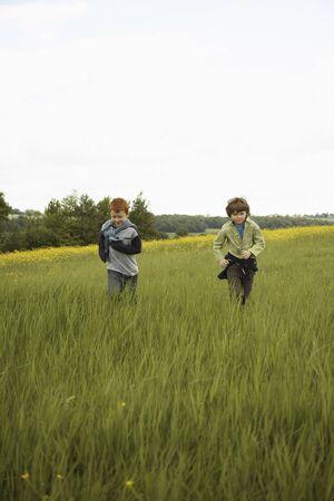 run down: Boys Running in Field