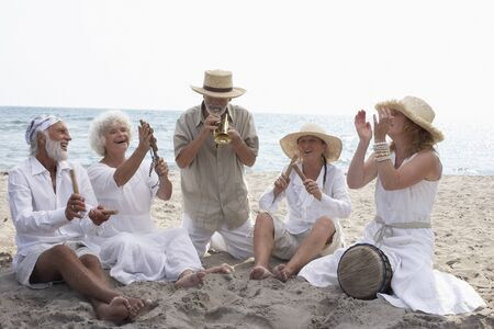 down beat: People Playing Music on Beach