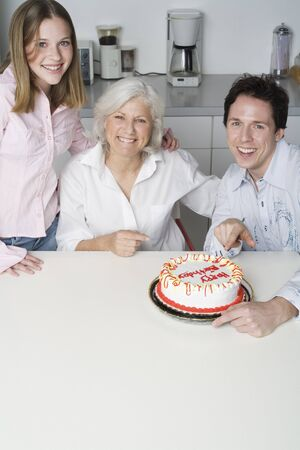 counter top: Grandmother Receiving Birthday Cake from Grandchildren