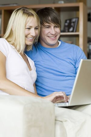 Couple Using Laptop Computer LANG_EVOIMAGES