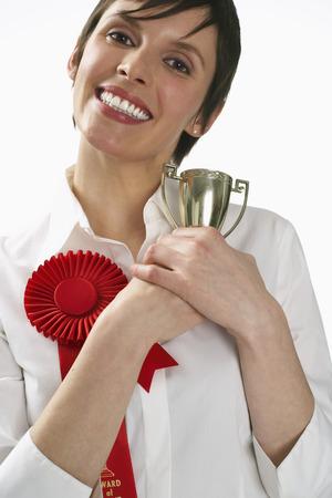 achievment: Woman Holding Trophy
