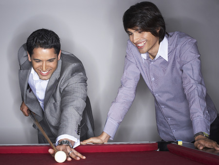 Business People Playing Pool LANG_EVOIMAGES