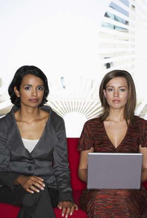 Businesswomen Using Laptop Computer LANG_EVOIMAGES