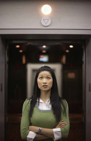 Woman in Front of Elevator LANG_EVOIMAGES