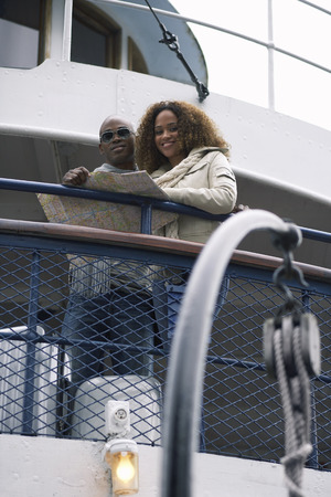 perturbed: Couple on Ferry Using Map