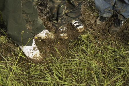discolorations: Close-up of Childrens Muddy Feet LANG_EVOIMAGES