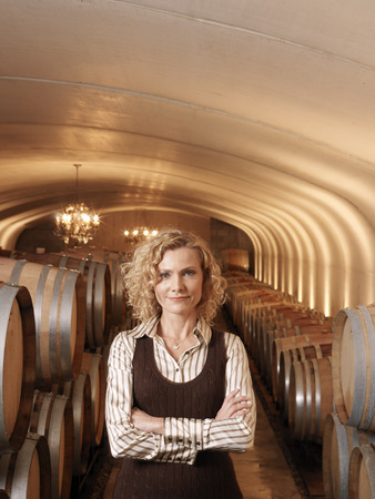 storage: Woman Standing in Wine Cellar