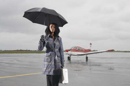 wetting: Businesswoman on Tarmac
