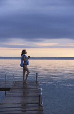 Woman on Dock by Water