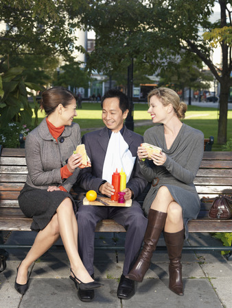 People Eating Lunch on Park Bench