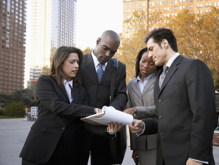 explained: Business People Talking Outdoors LANG_EVOIMAGES