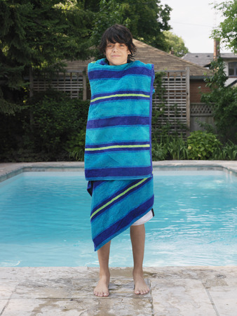 Boy Standing by Swimming Pool