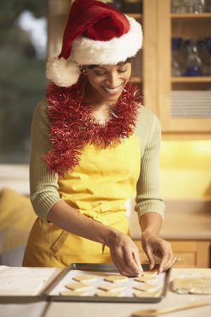 sheet: Woman in Santa Hat Making Cookies LANG_EVOIMAGES