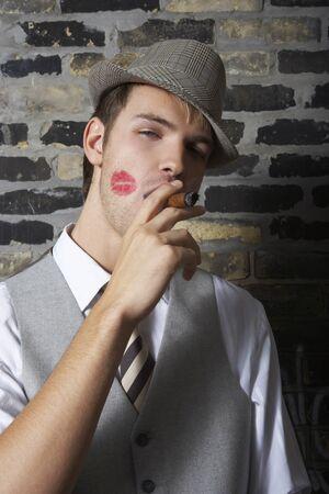 Portrait of Man With Lipstick Mark on Cheek, Smoking a Cigar