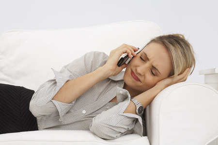 Businesswoman Using Cellular Phone