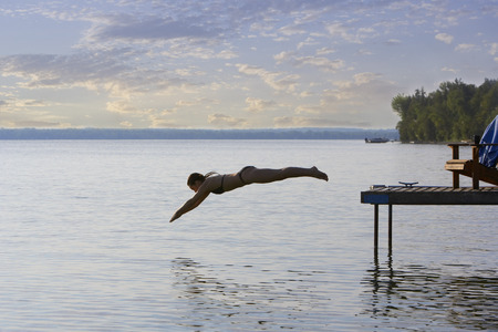 Woman Diving off of Dock