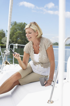 Woman on Boat with Cellular Phone