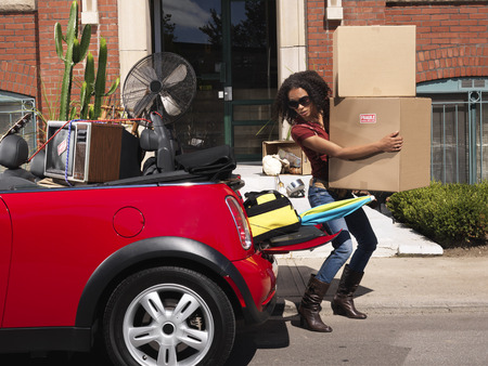 Woman Packing Car Full of Belongings