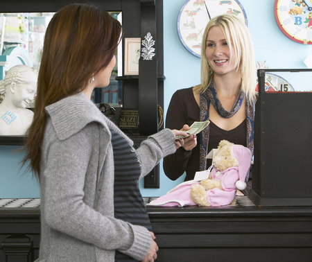 merchant: Pregnant Woman Shopping in Baby Store