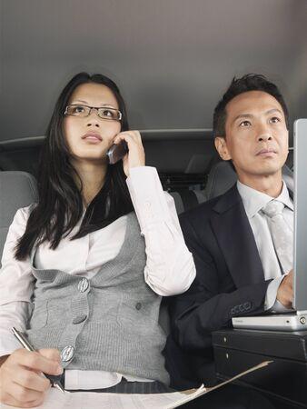 run down: Businesspeople in Car