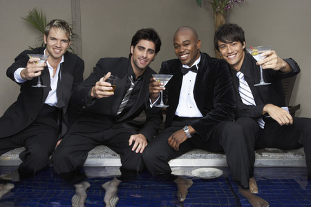 nightspot: Men in Formal Wear with Feet in Pool Drinking Cocktails