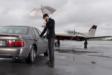 wetting: Man Opening Car Door on Airport Tarmac