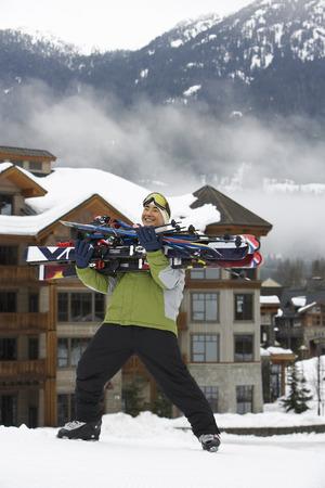 Man Carrying Skis, Whistler, British Columbia, Canada