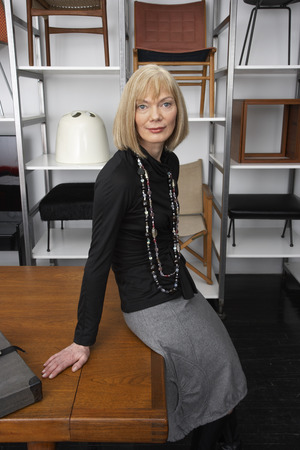 retailer: Portrait of Woman in Furniture Store LANG_EVOIMAGES