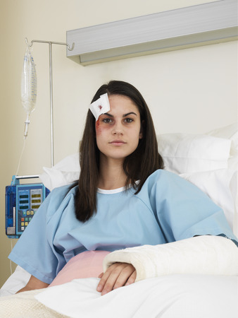Woman in Hospital with Black Eye and Cast